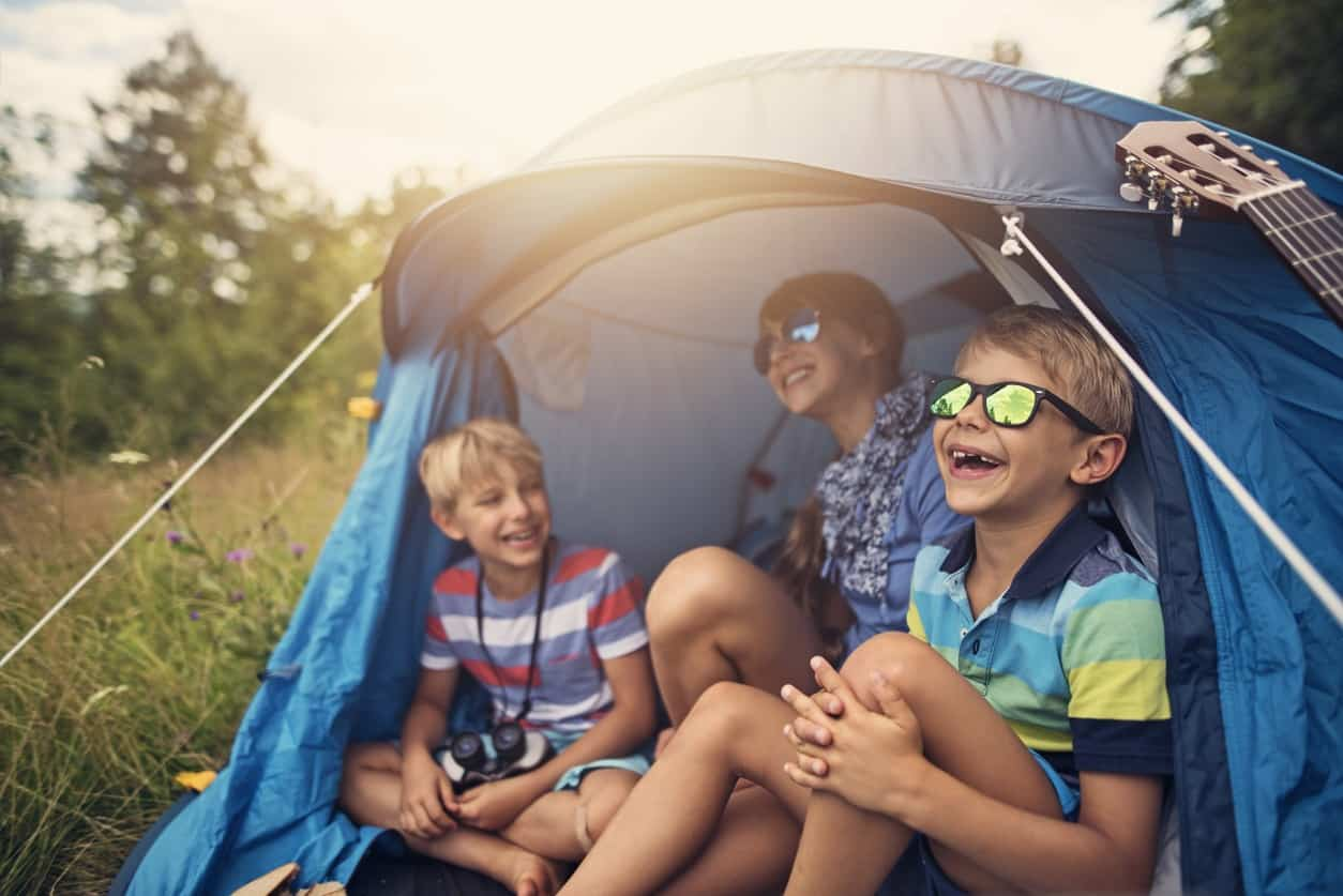 kids camping outdoors in tent