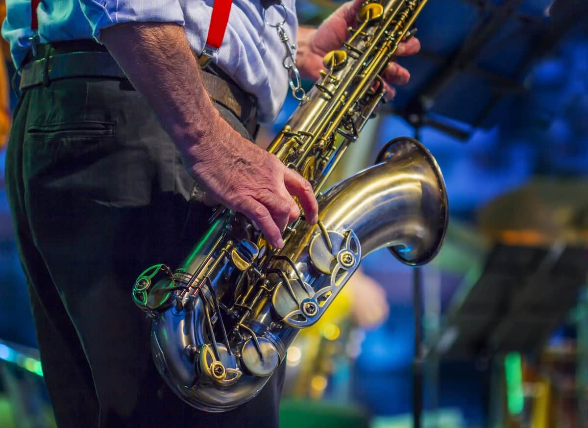 man playing saxophone at jazz festival