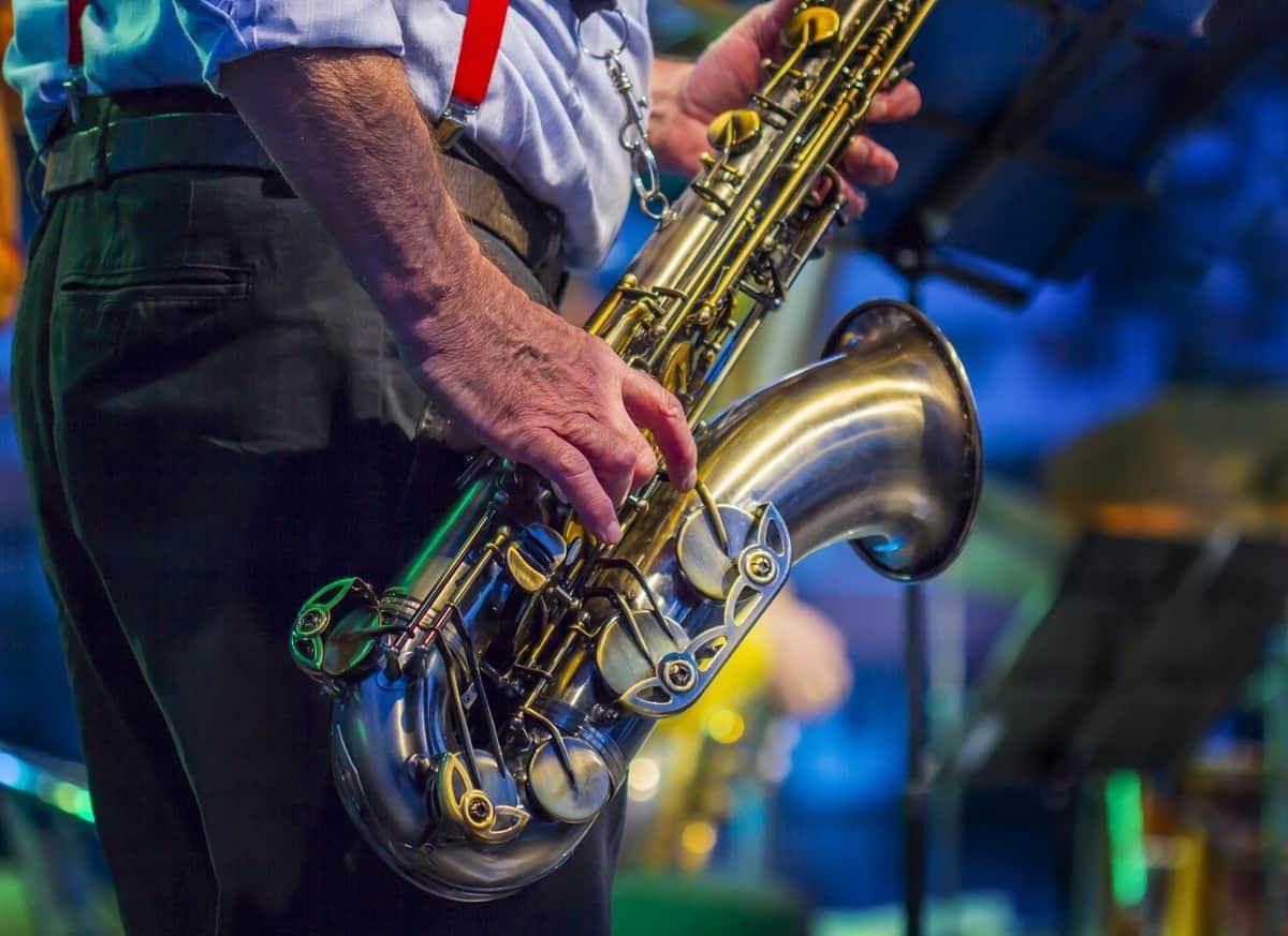 man playing saxophone at jazz festival