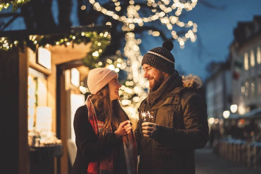 Couple participating in Iowa City winter activities.